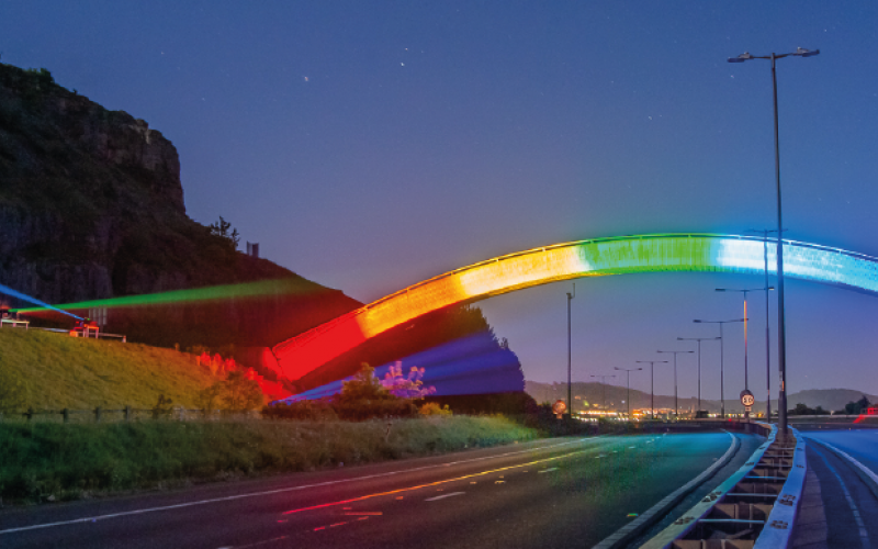 'Thank you key workers' rainbow projected onto a bridge at dusk